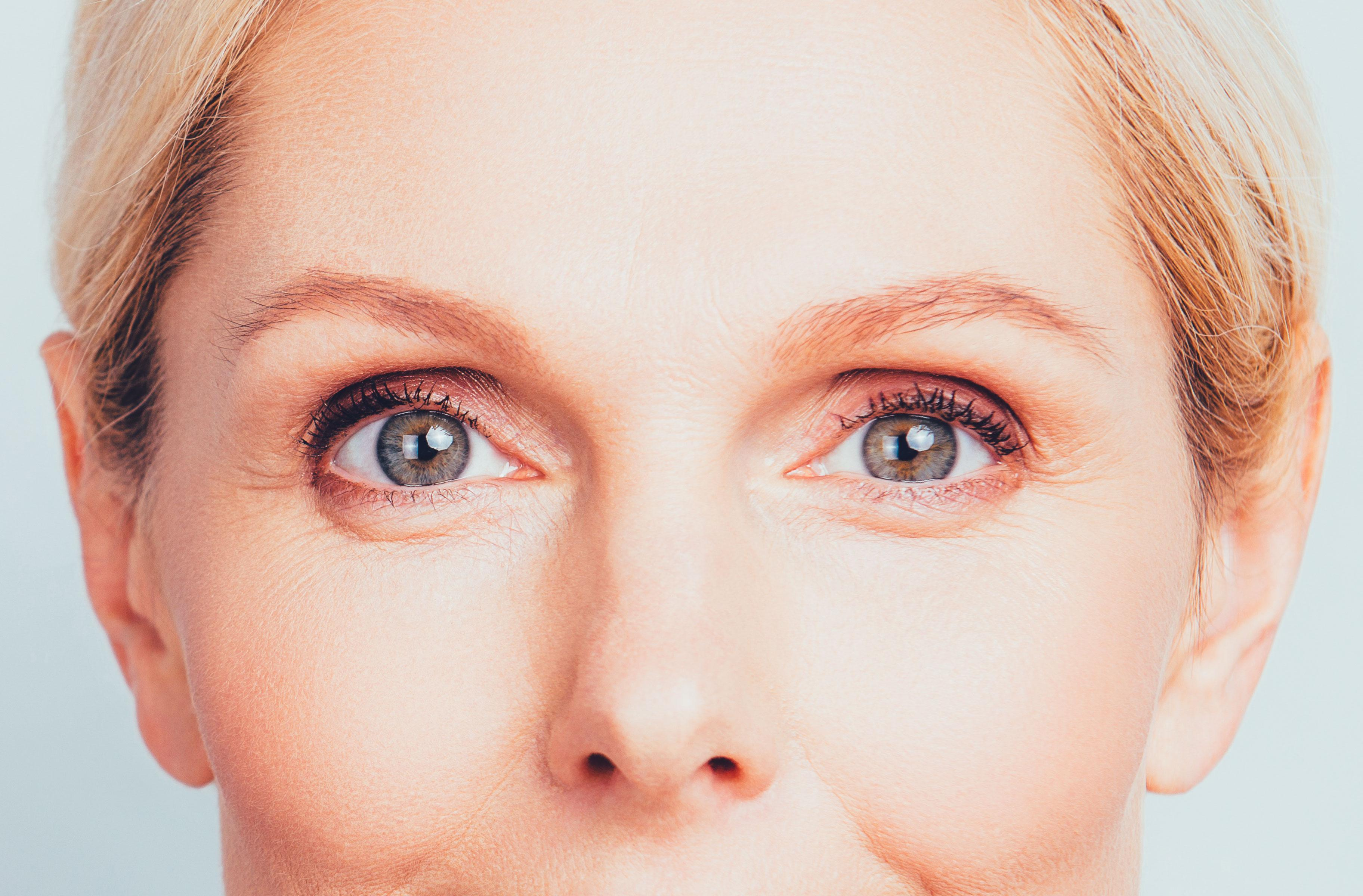 A blue-eyed woman is staring deeply