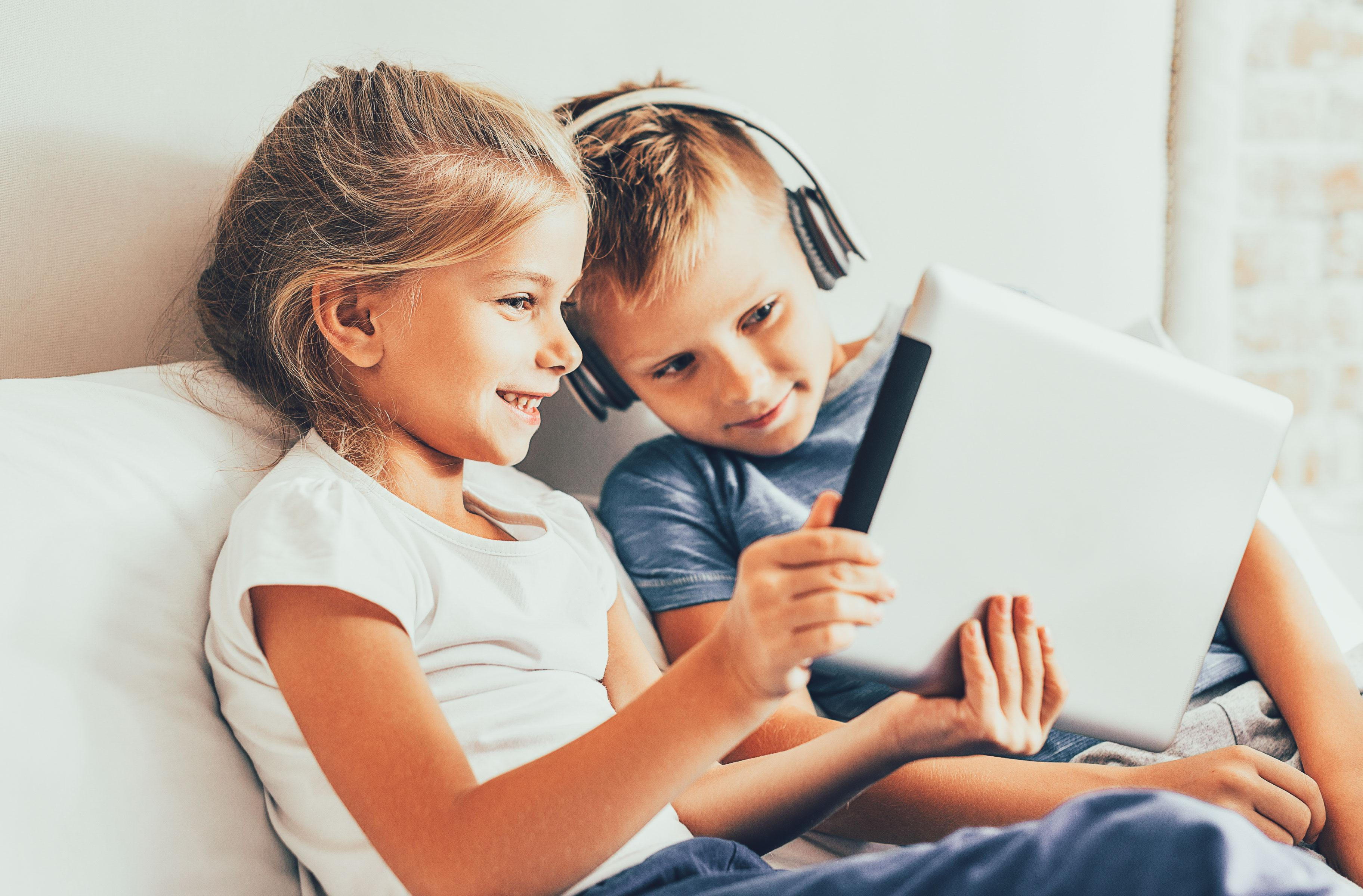 Two children's play with iPad