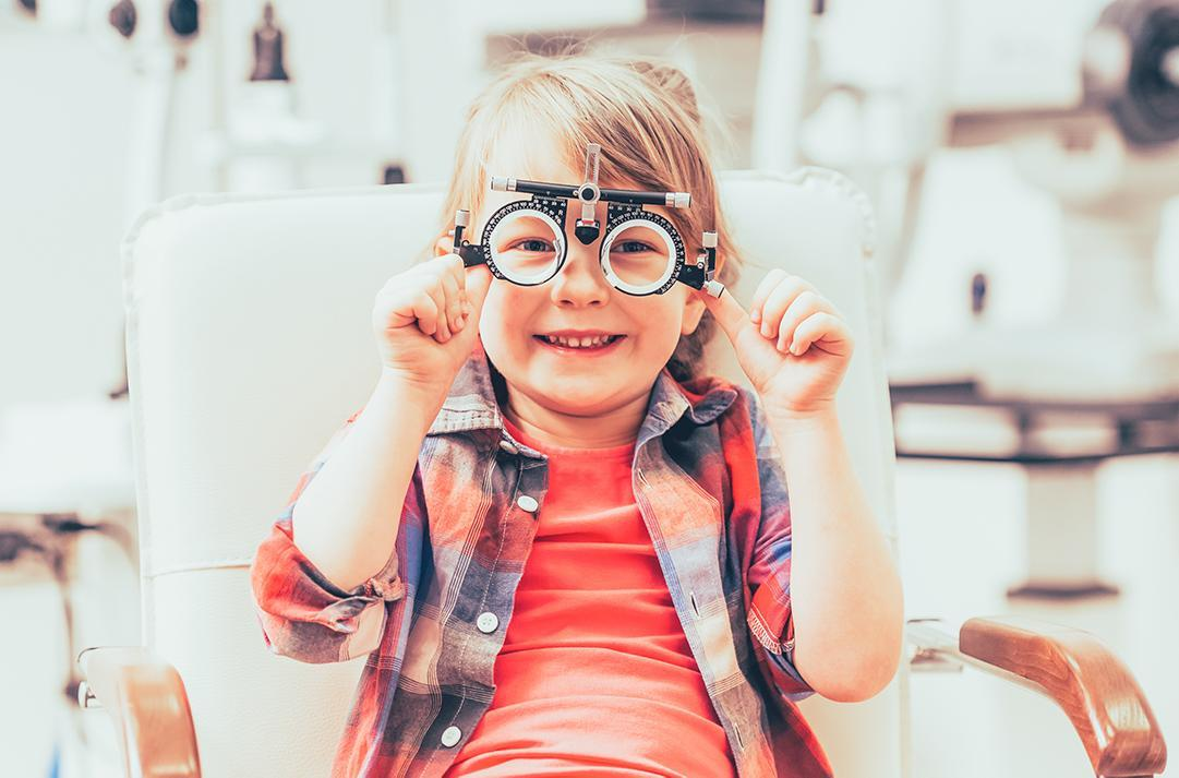 A child wearing an optometry measuring device on their eyes