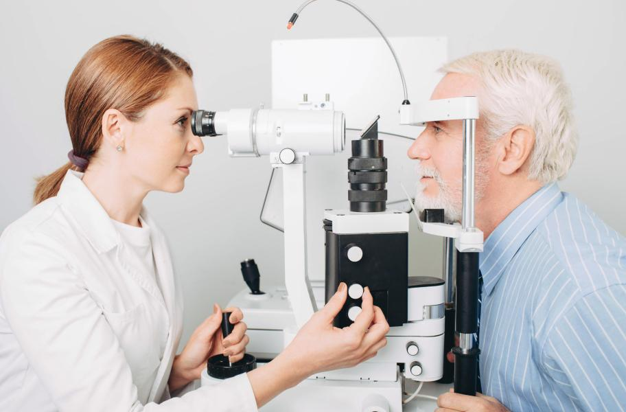 An IRIS optometrist examines a patient's eyes.