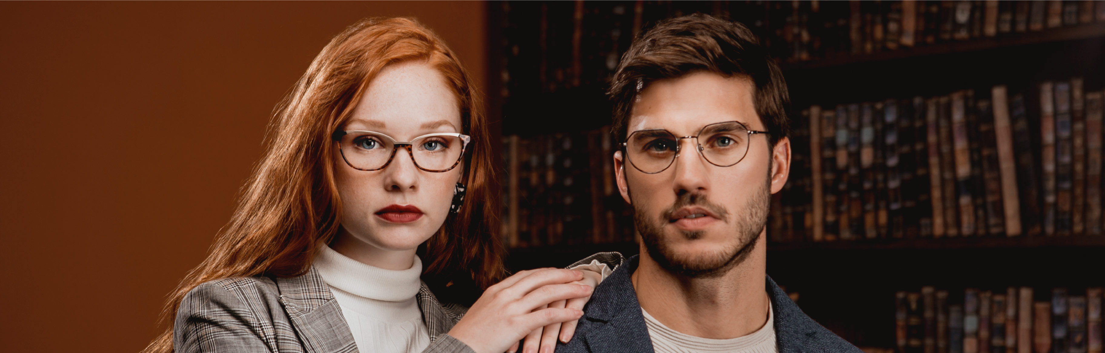 A woman is wearing Seraphin Gramercy glasses and a man is wearing Seraphin Langford glasses