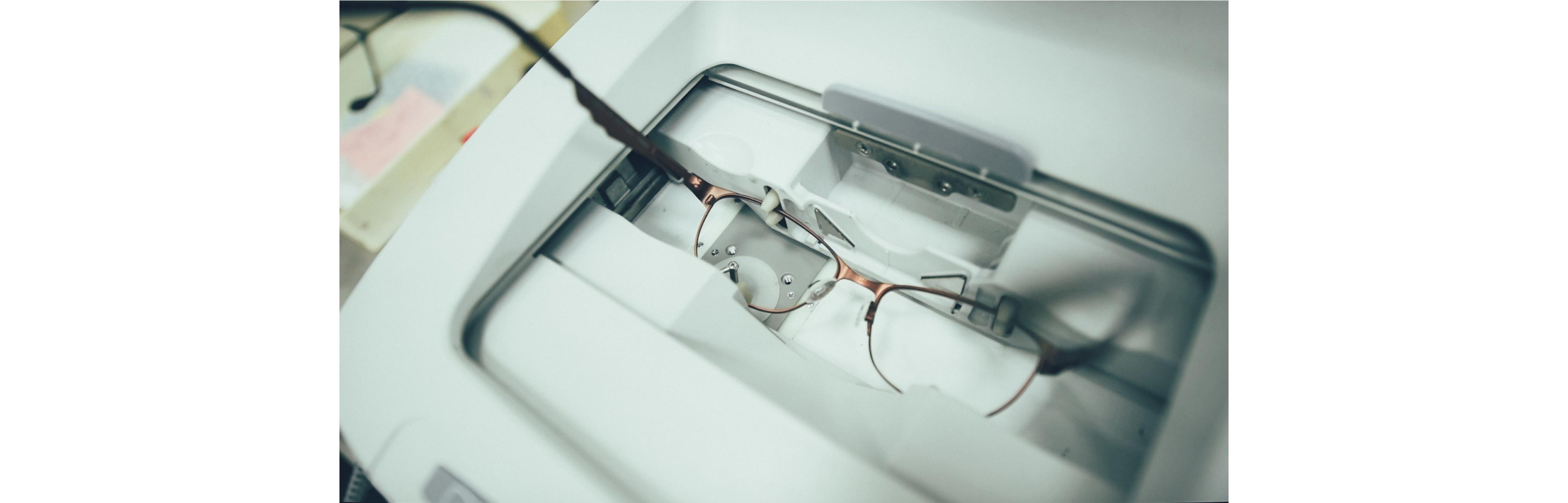 The lenses of glasses are being analyzed by a robot