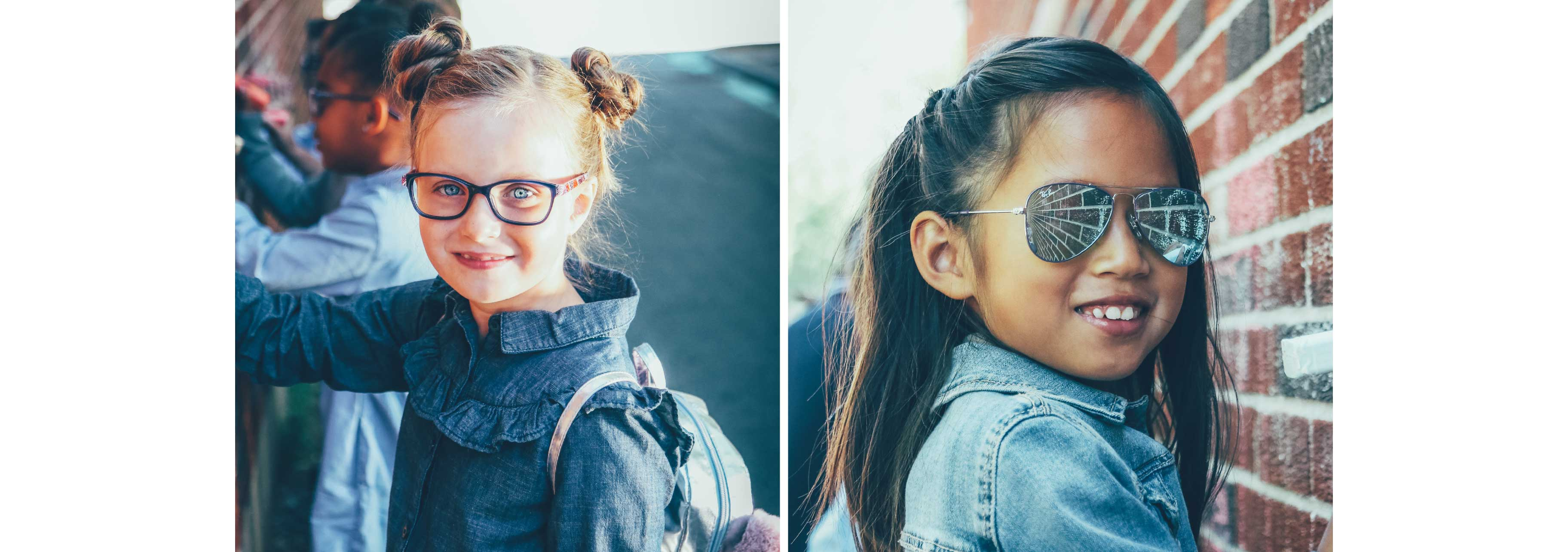 Two little girls are wearing glasses