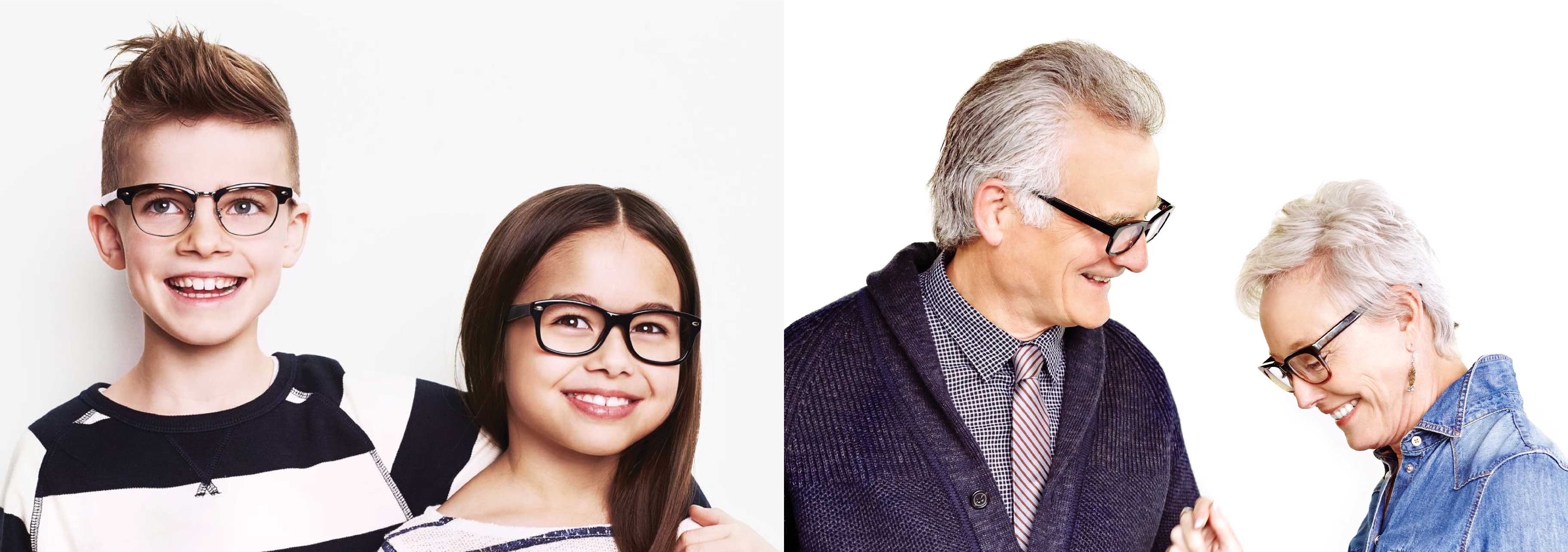 Two small children and two elder are wearing glasses and smiling