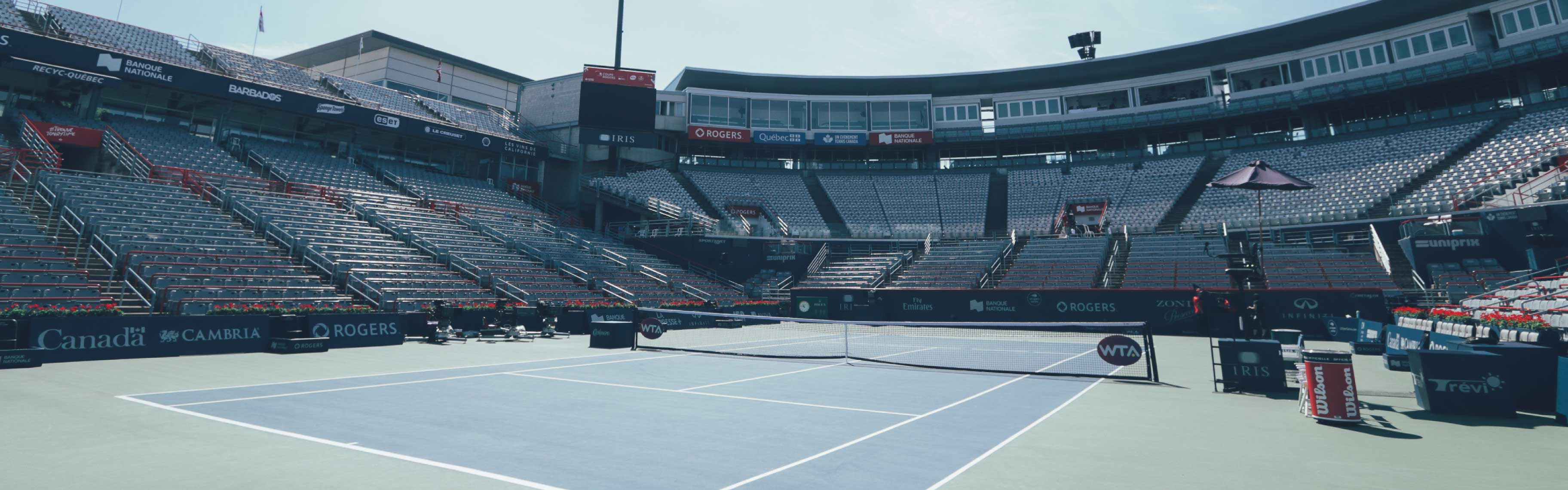 We see the central court of the IGA Stadium during the Rogers Cup, the IRIS logo is on the side of the court and under the giant screen